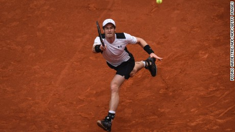 Andy Murray stretches to return a ball against Rafael Nadal.