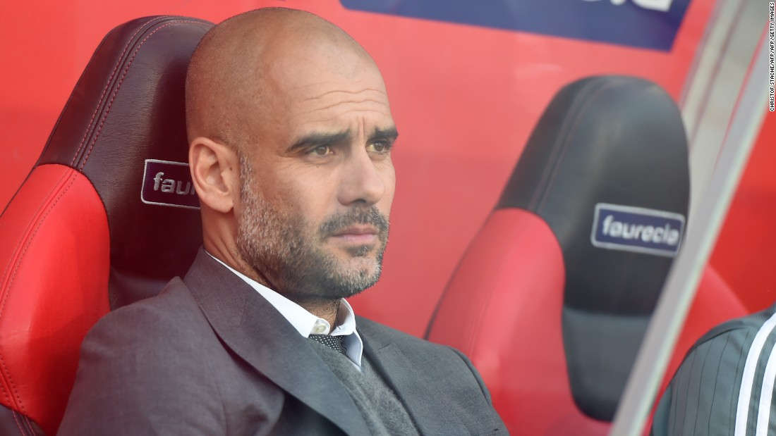 Bayern manager Pep Guardiola watches on from the sidelines.