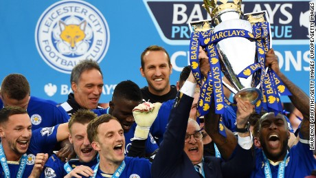 Captain Wes Morgan and manager Claudio Ranieri of Leicester City lift the Premier League trophy.