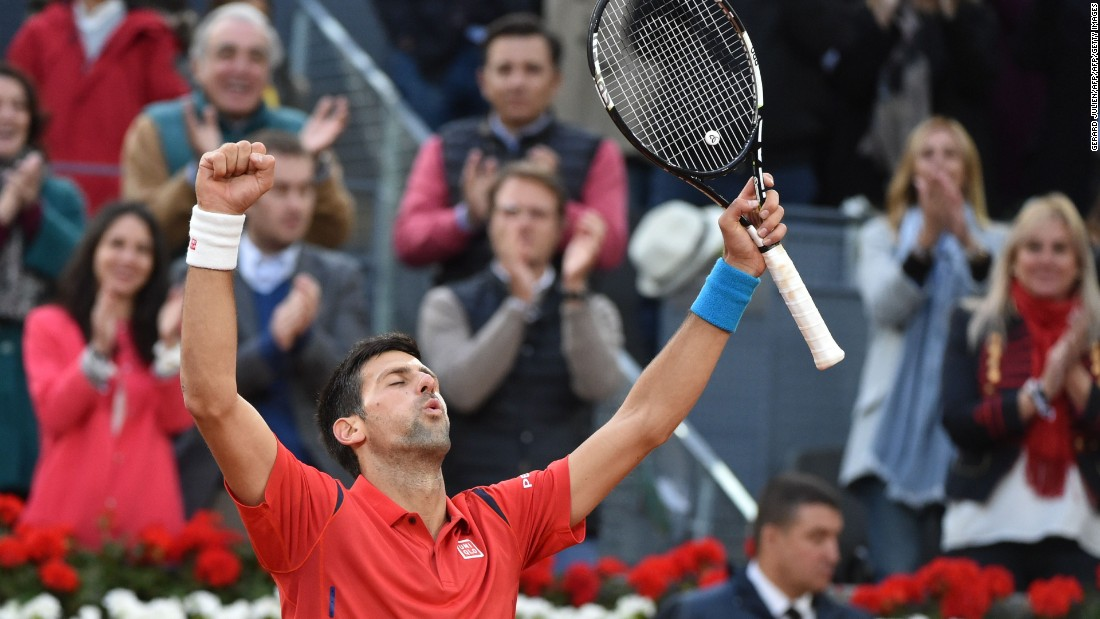 Novak Djokovic celebrates beating Andy Murray in the final of the 2016 Madrid Open.