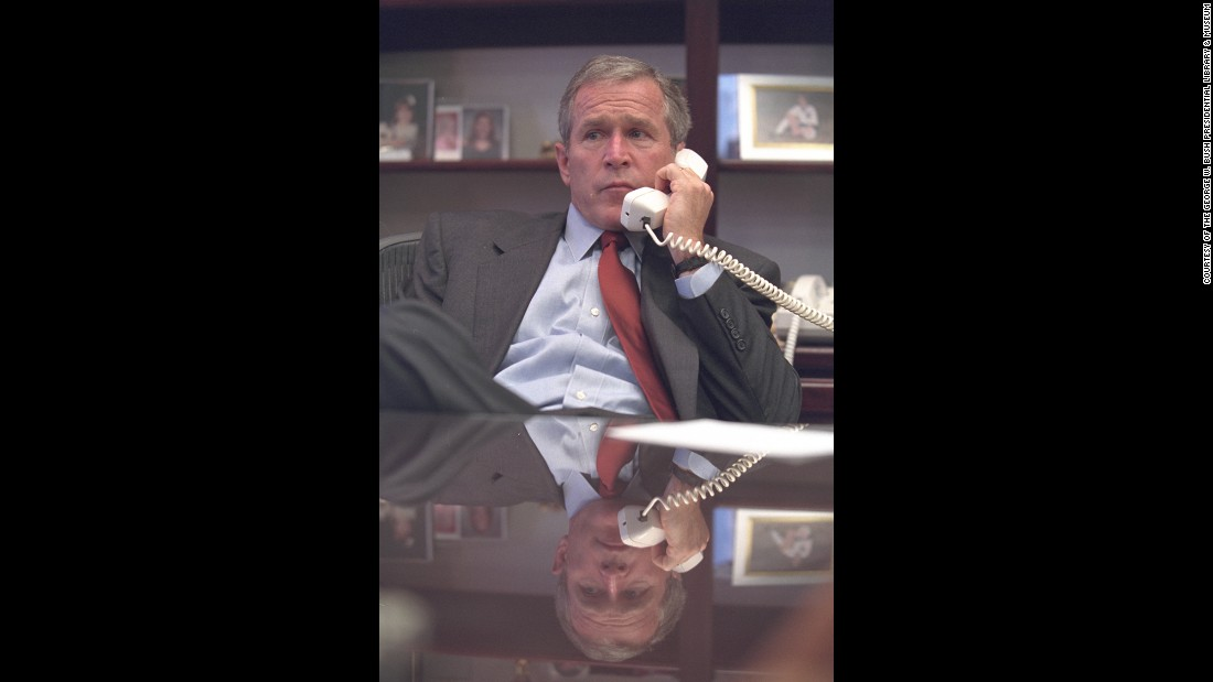 Bush talks on the phone at Barksdale Air Force Base.