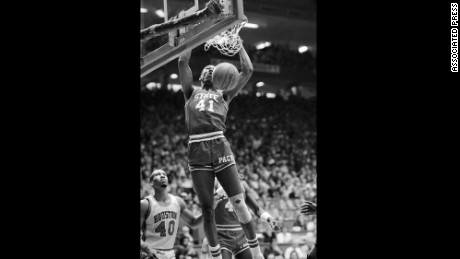 North Carolina State forward Thurl Bailey dunks the ball during the NCAA championship game against Houston in Albuquerque, New Mexico in 1983. NC State won the national championship, 54-52.