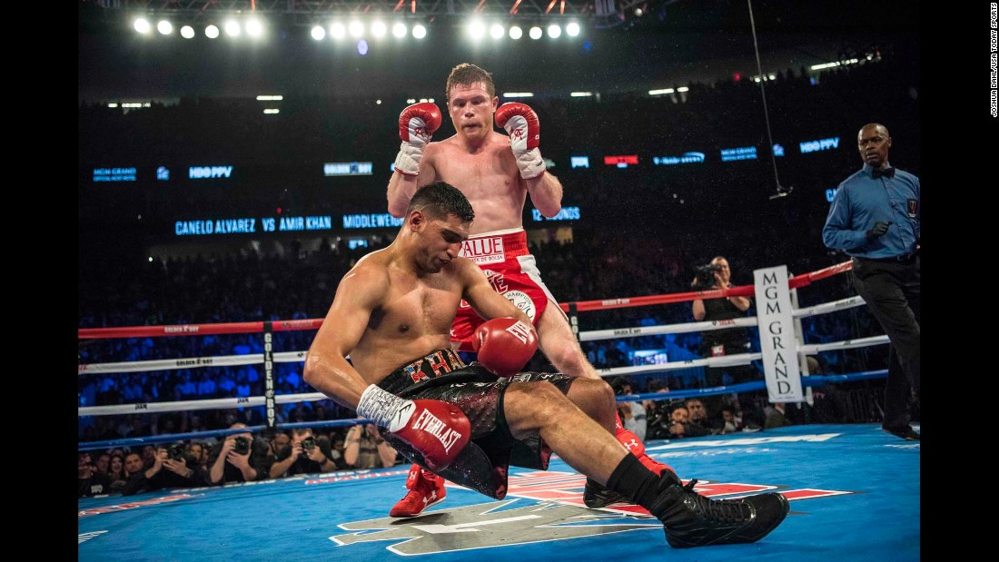 Canelo Alvarez knocks out Amir Khan during the sixth round of their middleweight title fight in Las Vegas on Saturday, May 7.