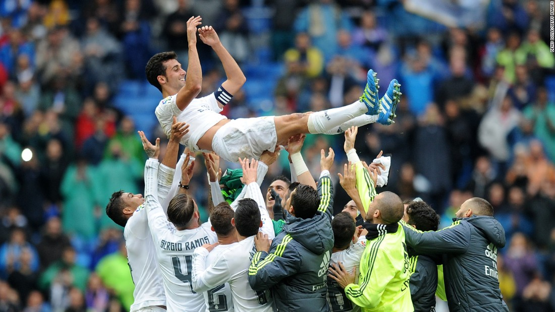 "Alvaro Arbeloa is thrown into the air by his Real Madrid teammates after playing his last home match for the club on Sunday, May 8. The defender's contract is expiring at the end of the season. <a href=""http://edition.cnn.com/2016/05/08/football/la-liga-barcelona-real-madrid-atletico-madrid/index.html"">READ MORE: Barca one win away from title</a>"
