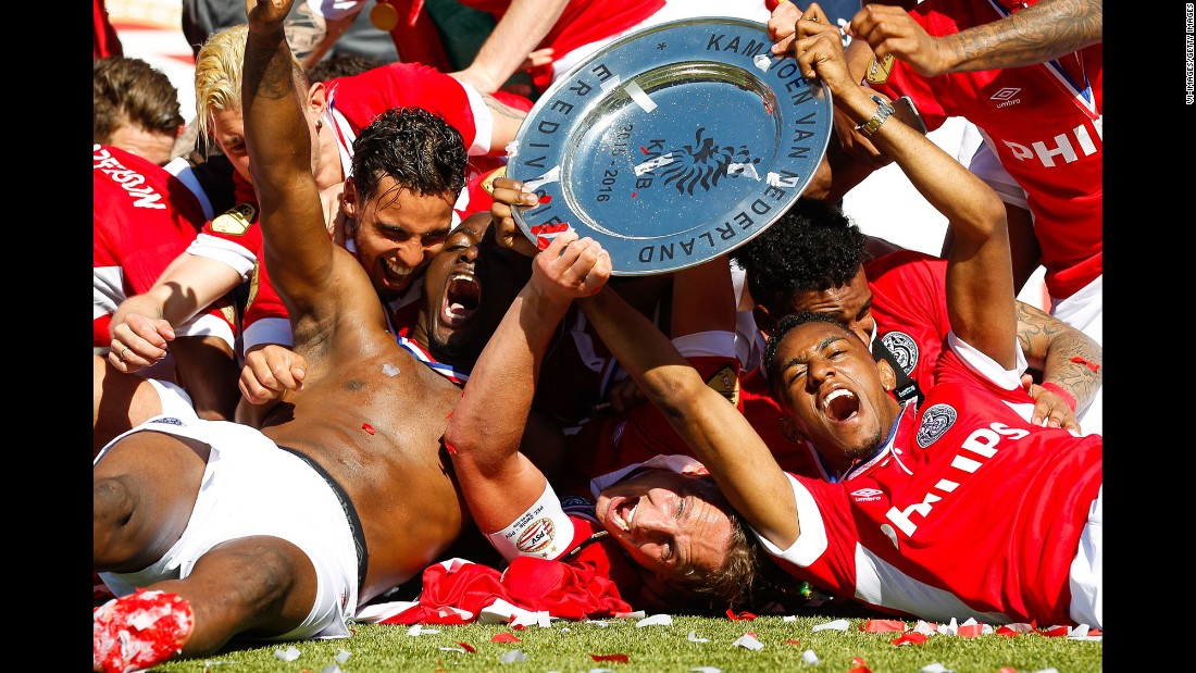 Soccer players from PSV Eindhoven celebrate together after winning the Dutch league in Zwolle on Sunday, May 8. It is the 23rd league title for PSV, which also won last season.