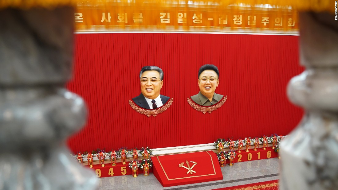 The images of former North Korean leaders Kim Il Sung (left) and Kim Jong Il adorn the convention center as the 7th Workers' Party Congress in Pyongyang takes place.