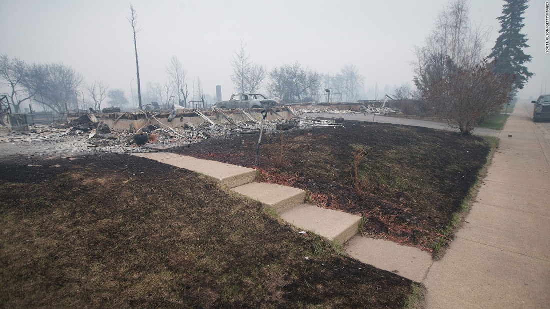 Foundations of homes are all that remain in parts of a residential neighborhood in Fort McMurray on May 7.