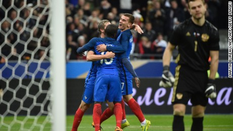N'Golo Kante (center) celebrates a debut France goal on his 25th birthday.