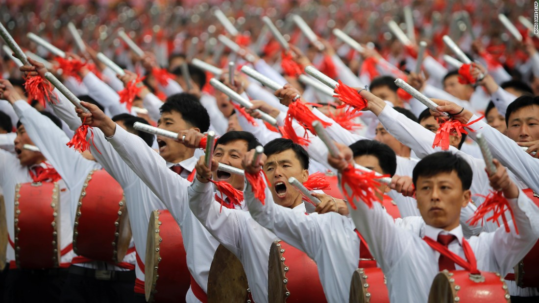 Hundreds of thousands of North Koreans celebrated the completed Workers' Party congress with a massive parade featuring floats bearing patriotic slogans and marchers with flags and pompoms.