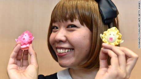 Japanese artist Megumi Igarashi shows small mascots shaped to represent a vagina  on April 15, 2015.