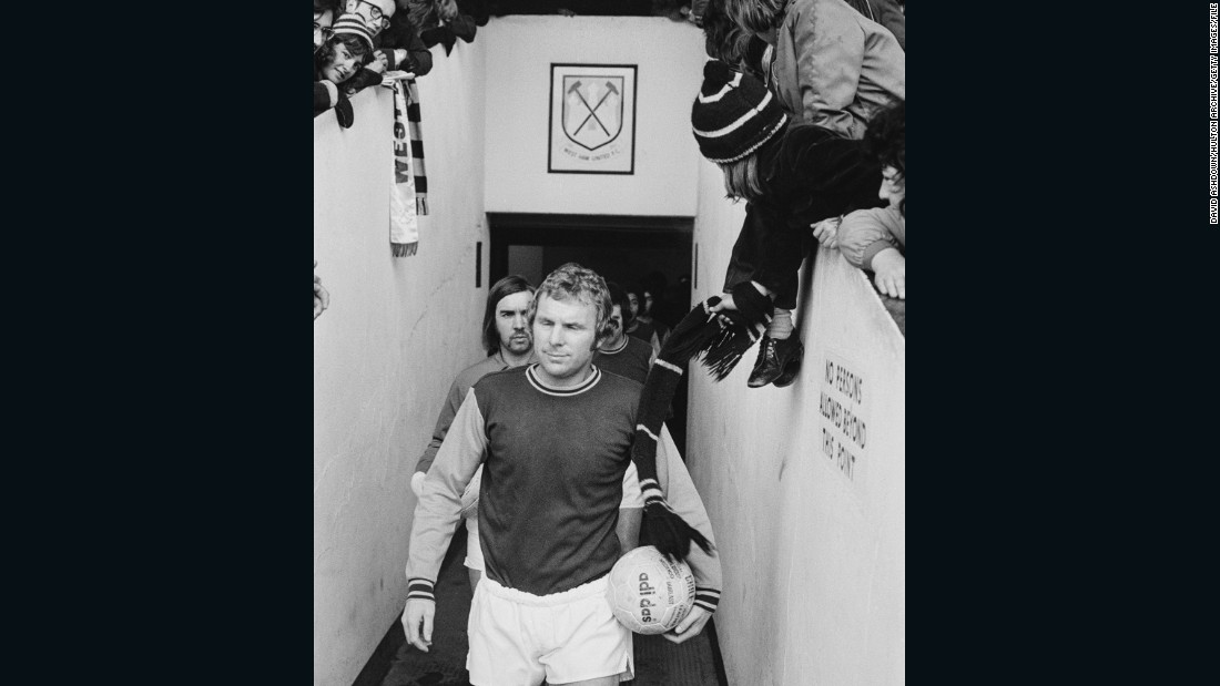 Moore leads the West Ham reserves onto the pitch before his final match at the Boleyn Ground on March 9, 1974 before his transfer to London rival Fulham.