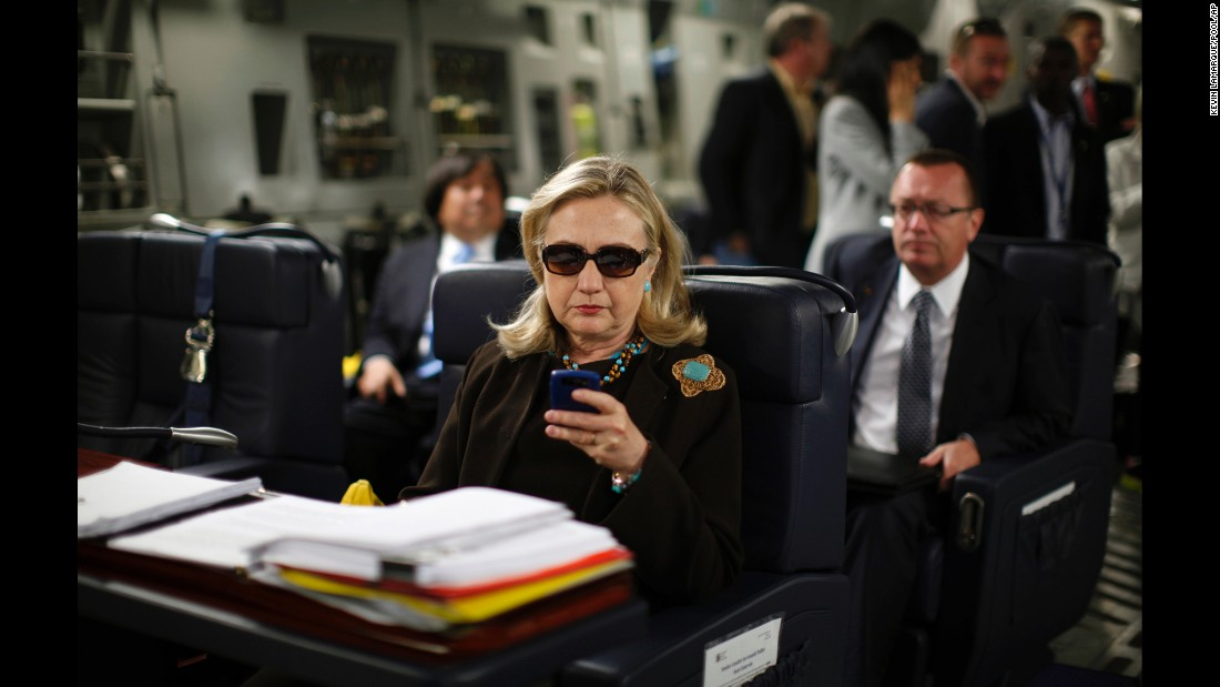 "Clinton checks her Blackberry inside a military plane after leaving Malta in October 2011. In 2015, The New York Times reported that Clinton exclusively used a personal email account during her time as secretary of state. The account, fed through its own server, raises security and preservation concerns. Clinton later said she used a private domain out of ""convenience,"" but admits in retrospect ""it would have been better"" to use multiple emails."