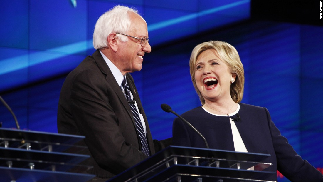 "U.S. Sen. Bernie Sanders shares a lighthearted moment with Clinton during a Democratic presidential debate in October 2015. It came after Sanders gave his take on the Clinton email scandal. ""The American people are sick and tired of hearing about the damn emails,"" Sanders said. ""Enough of the emails. Let's talk about the real issues facing the United States of America."""