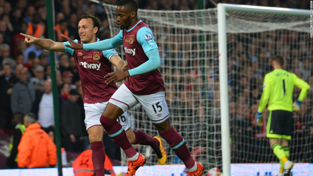 Senegalese striker Diafra Sakho celebrates with Mark Noble after putting West Ham ahead in the 10th minute of Tuesday's match.