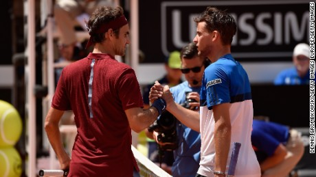 Roger Federer shakes hands with Dominic Thiem after his third-round loss at the Italian Open.