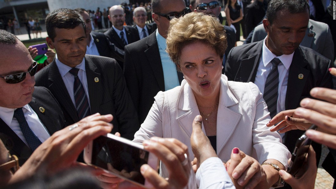 "Brazilian President Dilma Rousseff greets supporters outside the Planalto presidential palace in Brasilia, Brazil, on Thursday, May 12. Hours earlier, senators <a href=""http://www.cnn.com/2016/05/12/americas/brazil-rousseff-impeachment-vote/index.html"" target=""_blank"">voted to begin an impeachment trial</a> against her. Rousseff is accused of breaking budget laws, but she maintains she did the same things previous Brazilian leaders have done. ""I have made mistakes, but I have not committed any crimes. I am being judged unjustly, because I have followed the law to the letter,"" she said."
