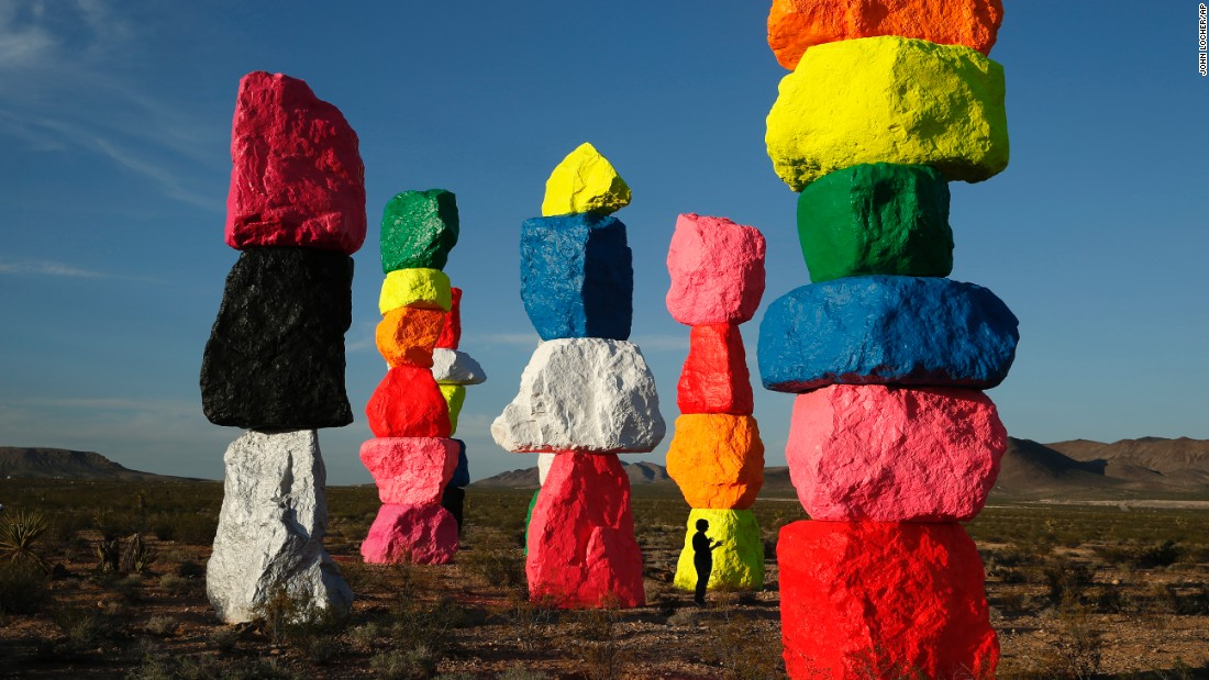 People visit Seven Magic Mountains, Ugo Rondinone's art installation near Jean, Nevada, on Wednesday, May 11