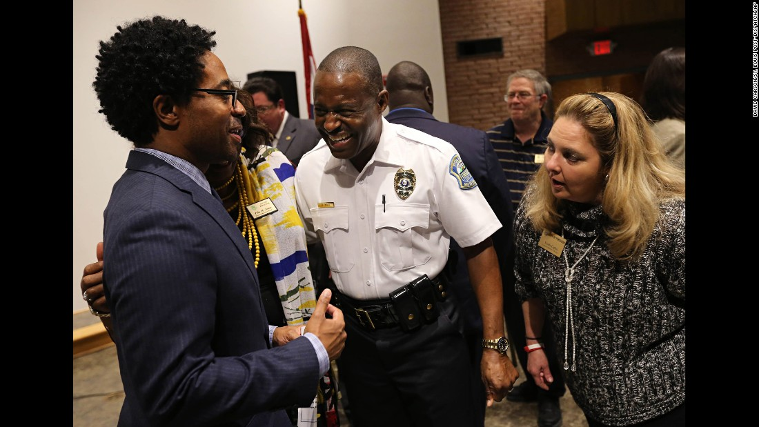 "Ferguson City Council members Wesley Bell, left, and Linda Lipka talk with <a href=""http://www.cnn.com/2016/05/09/us/ferguson-police-chief-delrish-moss/"" target=""_blank"">new police chief Delrish Moss</a> after he was sworn into office Monday, May 9, in Ferguson, Missouri. Moss is the first African-American police chief for Ferguson, where racially charged protests broke out after the 2014 shooting death of teenager Michael Brown."