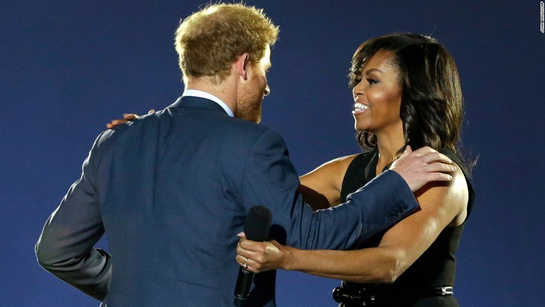 Britain's Prince Harry greets first lady Michelle Obama during the opening ceremony of the Invictus Games, which took place Sunday, May 8, in Kissimmee, Florida. The Invictus Games were created by Prince Harry for wounded, injured and sick service members. Fifteen countries participated this year.