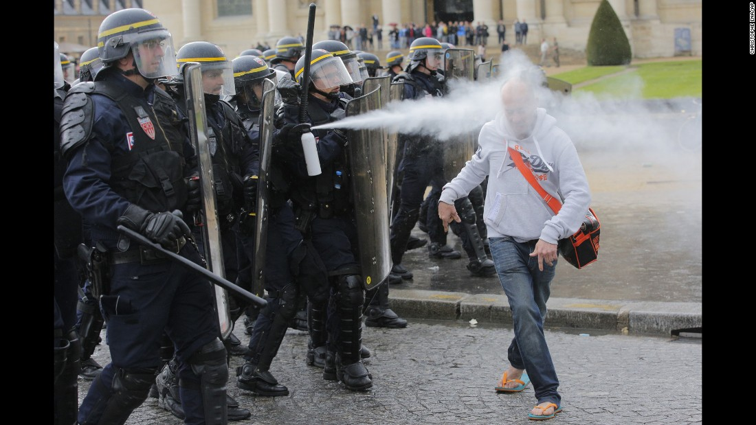 "Police in Paris use pepper spray on a man protesting new labor laws on Thursday, May 12. The legislation, which allows for longer workdays and easier layoffs, <a href=""http://www.nytimes.com/2016/05/11/world/europe/france-hollande-labor-law-changes.html"" target=""_blank"">was pushed through Parliament without a vote.</a>"