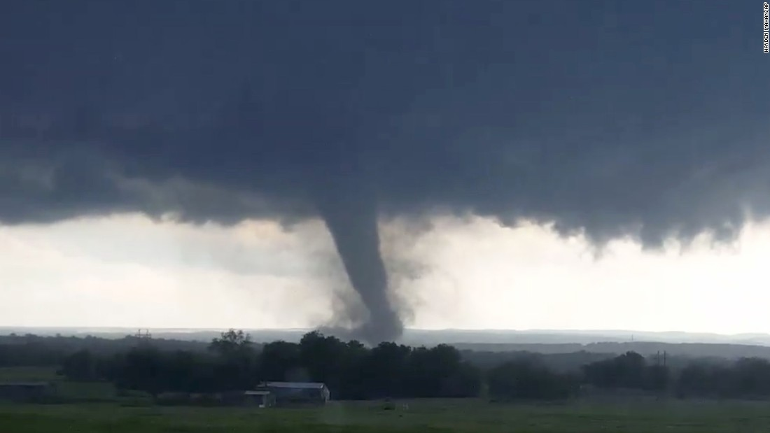 "This image, made from a video taken through a car window, shows a tornado near Wynnewood, Oklahoma, on Monday, May 9. <a href=""http://www.cnn.com/2016/05/09/weather/oklahoma-tornadoes/"" target=""_blank"">Tornadoes rumbled through the heart of Oklahoma</a> on Monday, killing at least two people and damaging structures."
