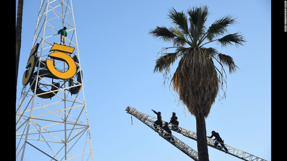 "Los Angeles police officers climb fire ladders to reach a man who had climbed the historic KTLA radio tower in Hollywood on Wednesday, May 11. The man <a href=""http://www.latimes.com/local/lanow/la-me-ln-sunset-boulevard-ktla-tower-20160511-story.html"" target=""_blank"">eventually climbed down</a> and was taken into custody for a mental evaluation."