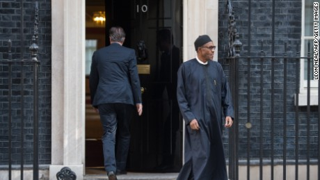 Britain's Prime Minister David Cameron (L) leaves Nigeria's President-elect Muhammadu Buhari following a meeting in Downing Street, central London on May 23, 2015. AFP PHOTO / LEON NEAL        (Photo credit should read LEON NEAL/AFP/Getty Images)