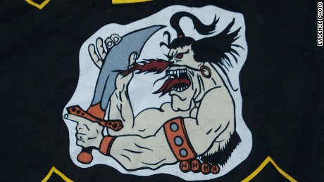 The Cossacks patch features a caricature of a wild-eyed, sneering cossack with scimitar poised to strike.