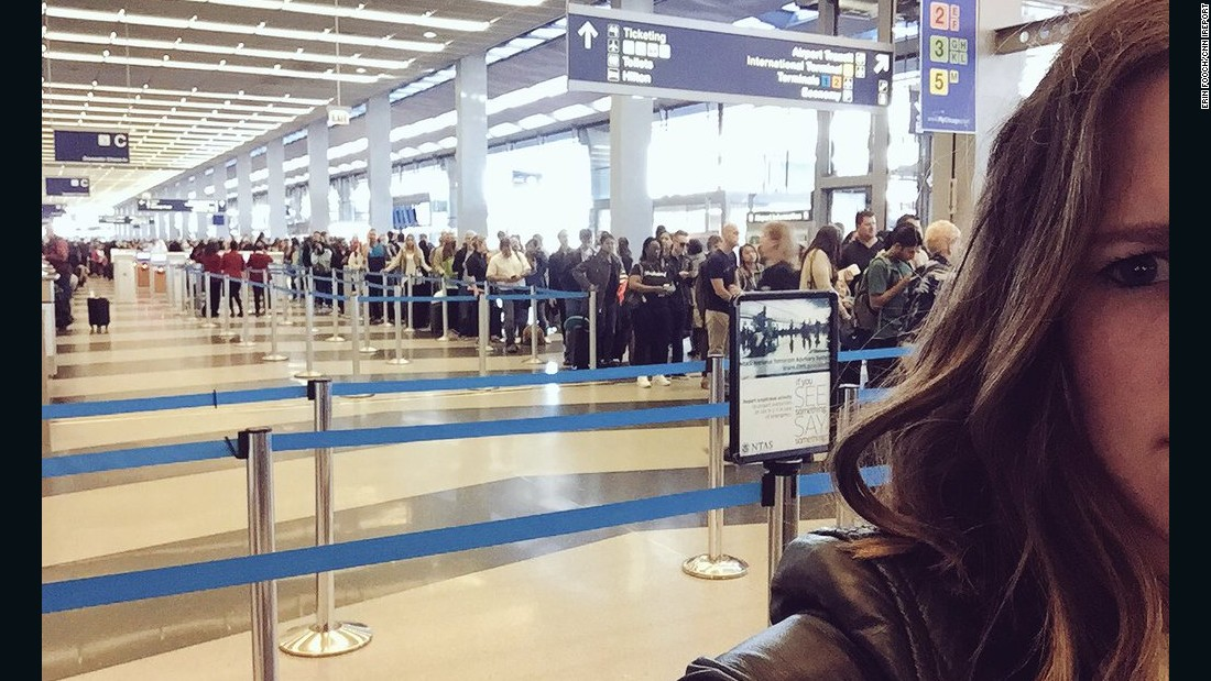 It took Erin Fooch two hours to get through security at O'Hare on Friday morning. She just made her flight, but her boss wasn't so fortunate.