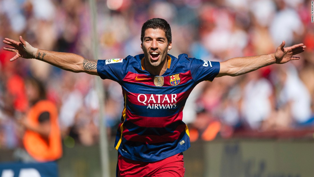Suarez celebrates his crucial opener for Barcelona in the win at Granada which kept it a point clear of Real.