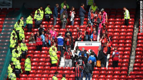 MANCHESTER, ENGLAND - MAY 15:  Fans are evacuated from the ground as the match is abandoned ahead of the Barclays Premier League match between Manchester United and AFC Bournemouth at Old Trafford on May 15, 2016 in Manchester, England.  (Photo by Alex Livesey/Getty Images)