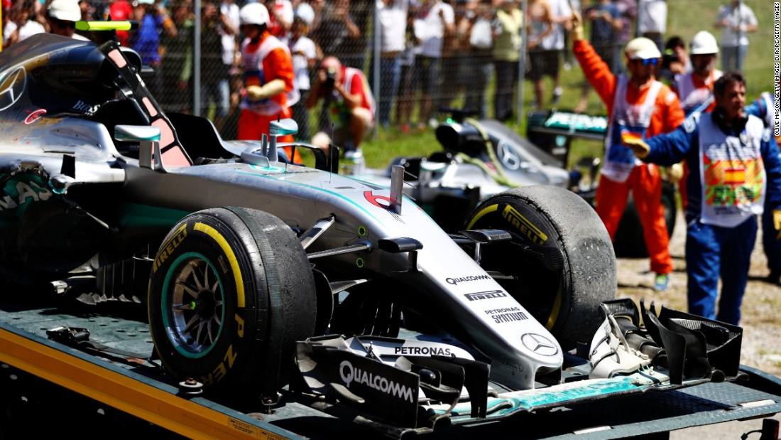 Rosberg's car is towed away from the side of the track following the collision.