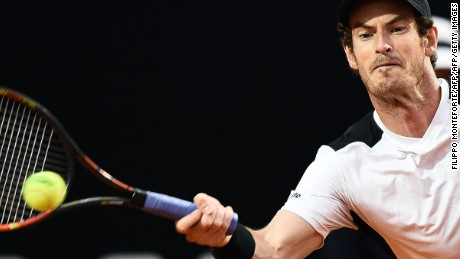 Andy Murray returns the ball to Novak Djokovic during their final Sunday.