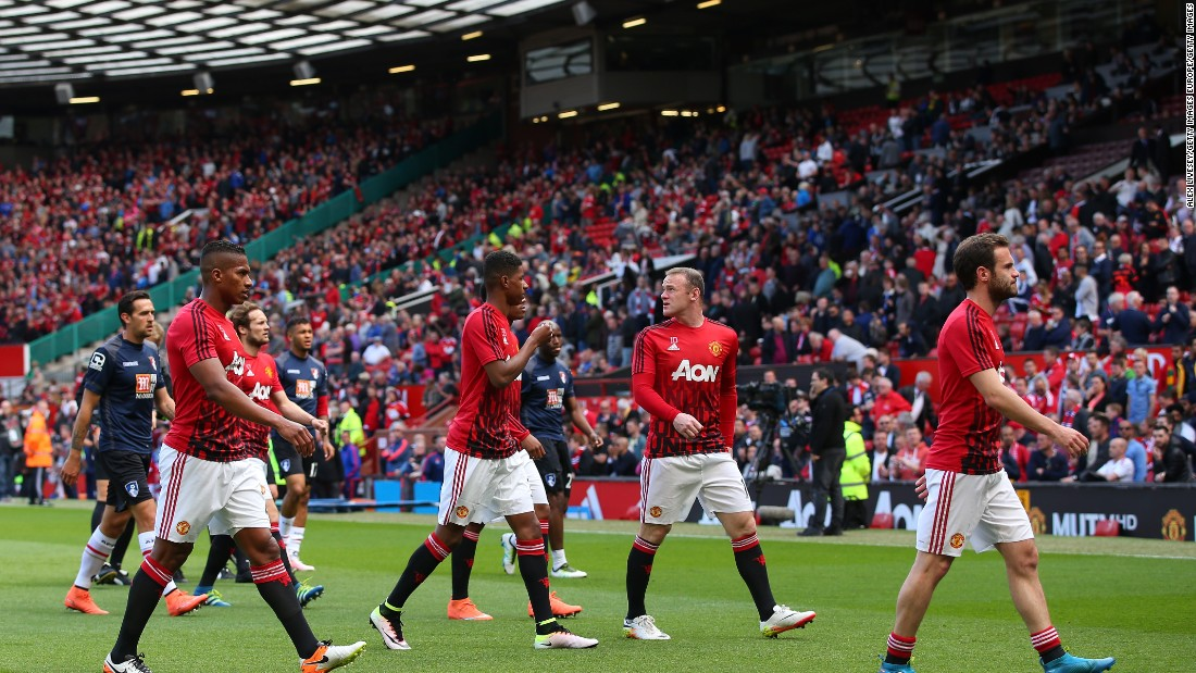 The Manchester United players, including Wayne Rooney, leave the field after warming up for what would have been their final game of the English Premier League season.