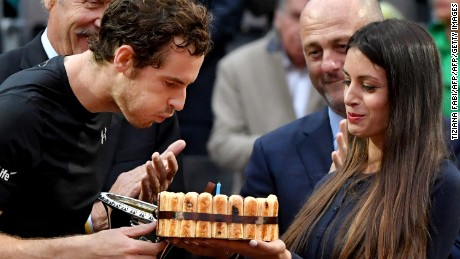 Murray is given a cake after his win to celebrate his 29th birthday