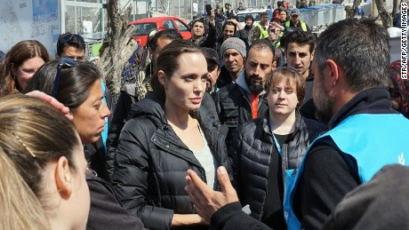 Hollywood star and UN special envoy Angelina Jolie (C) visits a refugee camp in Greece.