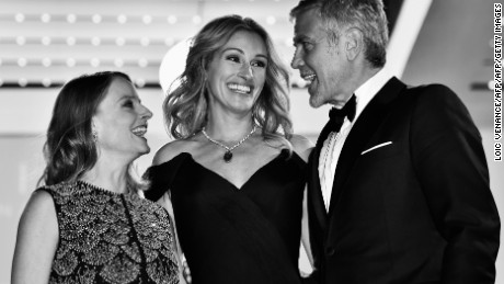 "US director Jodie Foster (L), US actress Julia Roberts (C) and US actor George Clooney pose on May 12, 2016 before leaving the Festival Palace after the screening of the film ""Money Monster"" at the 69th Cannes Film Festival in Cannes, southern France. / AFP / LOIC VENANCE        (Photo credit should read LOIC VENANCE/AFP/Getty Images)"