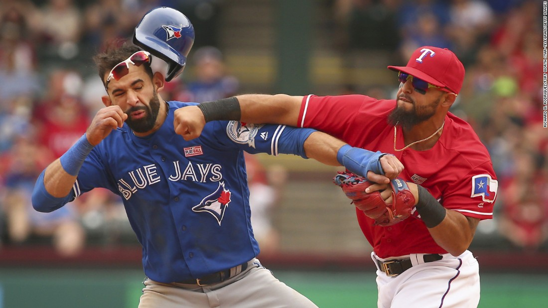 "Texas second baseman Rougned Odor, right, punches Toronto outfielder Jose Bautista during a Major League Baseball game in Arlington, Texas, on Sunday, May 15. <a href=""http://bleacherreport.com/articles/2640341-jose-bautista-rougned-odor-and-more-ejected-after-blue-jays-vs-rangers-brawl"" target=""_blank"">The confrontation,</a> which sparked a bench-clearing brawl, came after the base-running Bautista slid hard into second to try to break up a double play. Both players were ejected, as were several others involved in the brawl afterward."