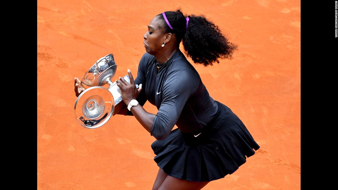 "Serena Williams drops a piece of the trophy she received after <a href=""http://www.cnn.com/2016/05/15/tennis/serena-williams-italian-open-tennis-andy-murray/"" target=""_blank"">winning the Italian Open</a> in Rome on Sunday, May 15."