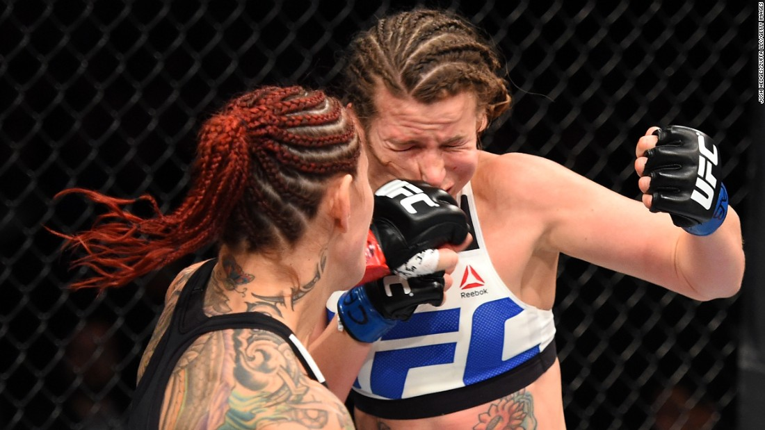 "Cris ""Cyborg"" Justino punches Leslie Smith during a UFC event in Curitiba, Brazil, on Saturday, May 14. Justino, widely regarded as one of the world's top female fighters, was making her UFC debut. She won with a first-round stoppage."