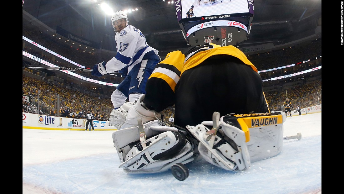 Tampa Bay forward Alex Killorn slips the puck past Pittsburgh's Matt Murray during Game 1 of the NHL's Eastern Conference Final on Friday, May 13. Tampa Bay won 3-1.
