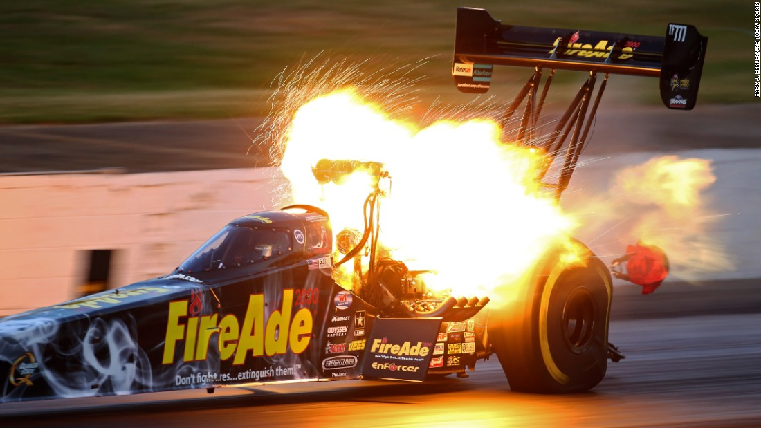 An engine explodes on the car of drag racer Leah Pritchett during the Southern Nationals in Commerce, Georgia, on Friday, May 13. It is a common sight in drag racing, where engines are pushed to their limits.