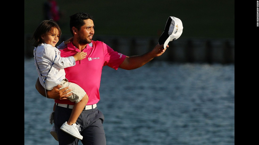 "The world's top-ranked golfer, Jason Day, celebrates with his son, Dash, after <a href=""http://www.cnn.com/2016/05/16/golf/jason-day-players-championship/index.html"" target=""_blank"">winning the Players Championship</a> on Sunday, May 15."