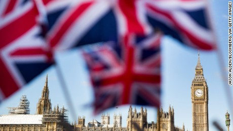 A display of U.K., Union Jack flags fly in front of The Houses of Parliament, in London, U.K., on Monday, February 15, 2016.