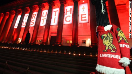 Candles adorn the steps of Liverpool's St Georges Hall on April 26, 2016, in remembrance of 96 Liverpool football fans who died in the Hillsborough stadium disaster.