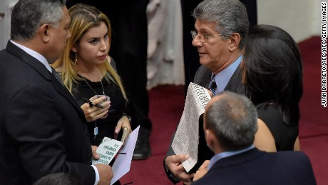 The president of the Venezuelan National Assembly Henry Ramos Allup (R) talks with deputy of the ruling party Pedro Carreno (L) during a special session in Caracas on May 17, 2016.  Venezuela's opposition on Tuesday urged the public to defy a state of emergency President Nicolas Maduro has decreed over a nation sapped by food shortages and a collapsing economy. / AFP / JUAN BARRETO        (Photo credit should read JUAN BARRETO/AFP/Getty Images)