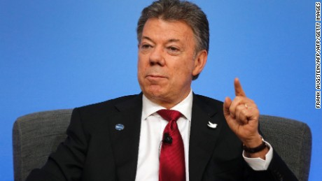 Colombian President Juan Manuel Santos gestures as he speaks during a panel discussion during the Anti-Corruption Summit London 2016, at Lancaster House in central London on May 12, 2016. British Prime Minister David Cameron kicked off a global anti-corruption summit on Thursday with a plan to stop the flow of dirty money into London property, but faces calls to do more to open up Britain's overseas tax havens. Cameron is pushing for new international commitments on tackling corruption from almost 50 nations and overseas territories attending the summit, including the leaders of Nigeria and Afghanistan, and US Secretary of State John Kerry. / AFP / POOL / Frank Augstein        (Photo credit should read FRANK AUGSTEIN/AFP/Getty Images)
