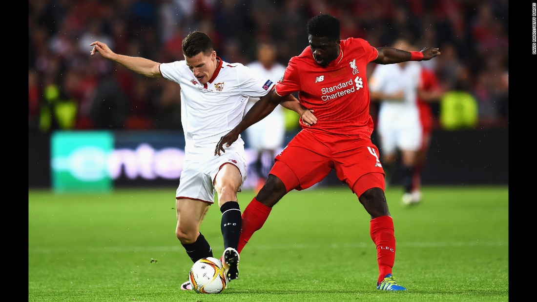 Gameiro competes for the ball with Liverpool's Kolo Toure.