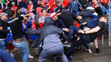 Fans scuffle prior to the UEFA Europa League Final match between Liverpool and Sevilla at St. Jakob-Park.