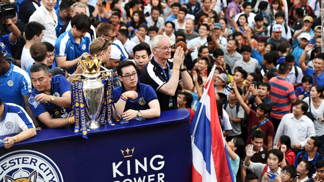 "Leicester City manager Claudio Ranieri (center) gives a traditional Thai ""wai"" gesture of welcome as fans of the English Premier League soccer champions greet the Thai-owned team in Thailand's capital, Bangkok. Ranieri steered Leicester, owned by billionaire businessman Vichai Srivaddhanaprabha, to the most unlikely triumph in Premier League history as it won the competition by 10 points from second-placed Arsenal. Jon Sanders, the Leicester player liaison officer, <a href=""http://www.leicestermercury.co.uk/Leicester-City-parade-Premier-League-trophy/story-29294144-detail/story.html"" target=""_blank"">told the Leicester Mercury newspaper</a>: ""One million people on the streets to welcome the Premier League champions in Bangkok. Incredible."""